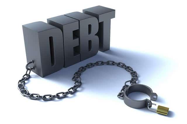 being in debt