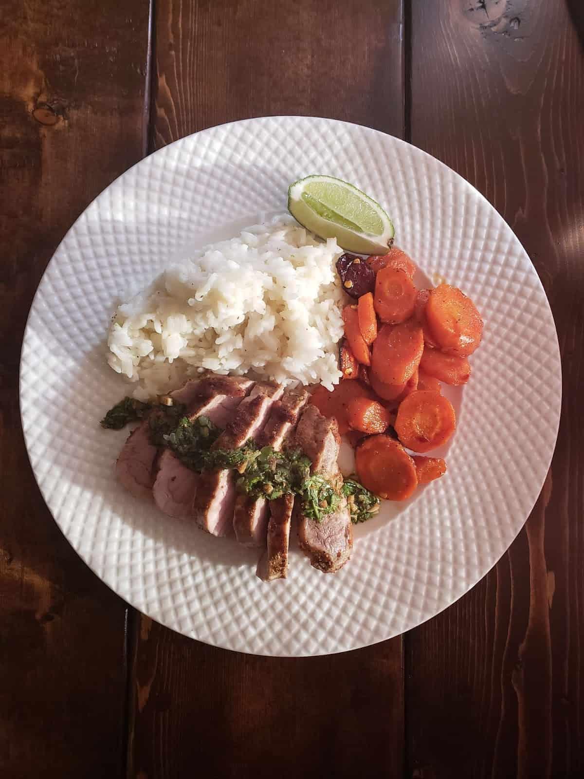 Chimichurri Pork Tenderloin with Honey Roasted Carrots & Lime Rice