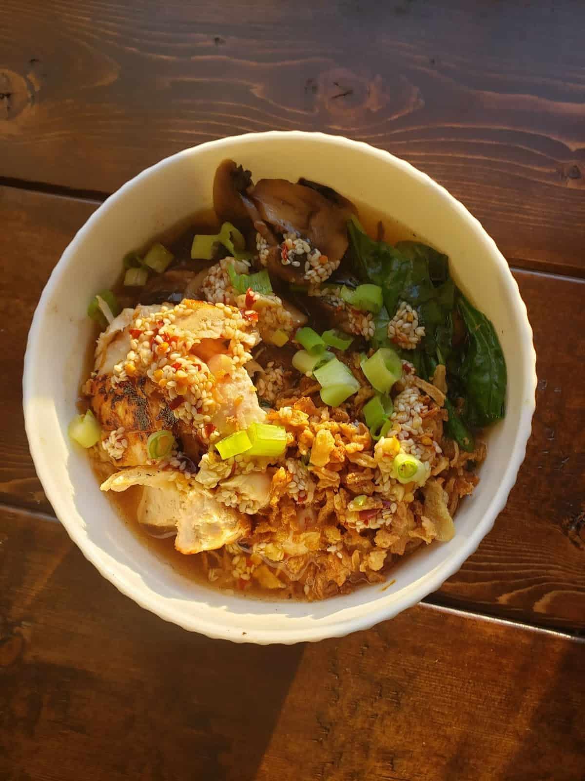 Chicken Ramen in a Shoyu-Style Broth with Mushrooms, Chili Garlic Oil & Crispy Onions