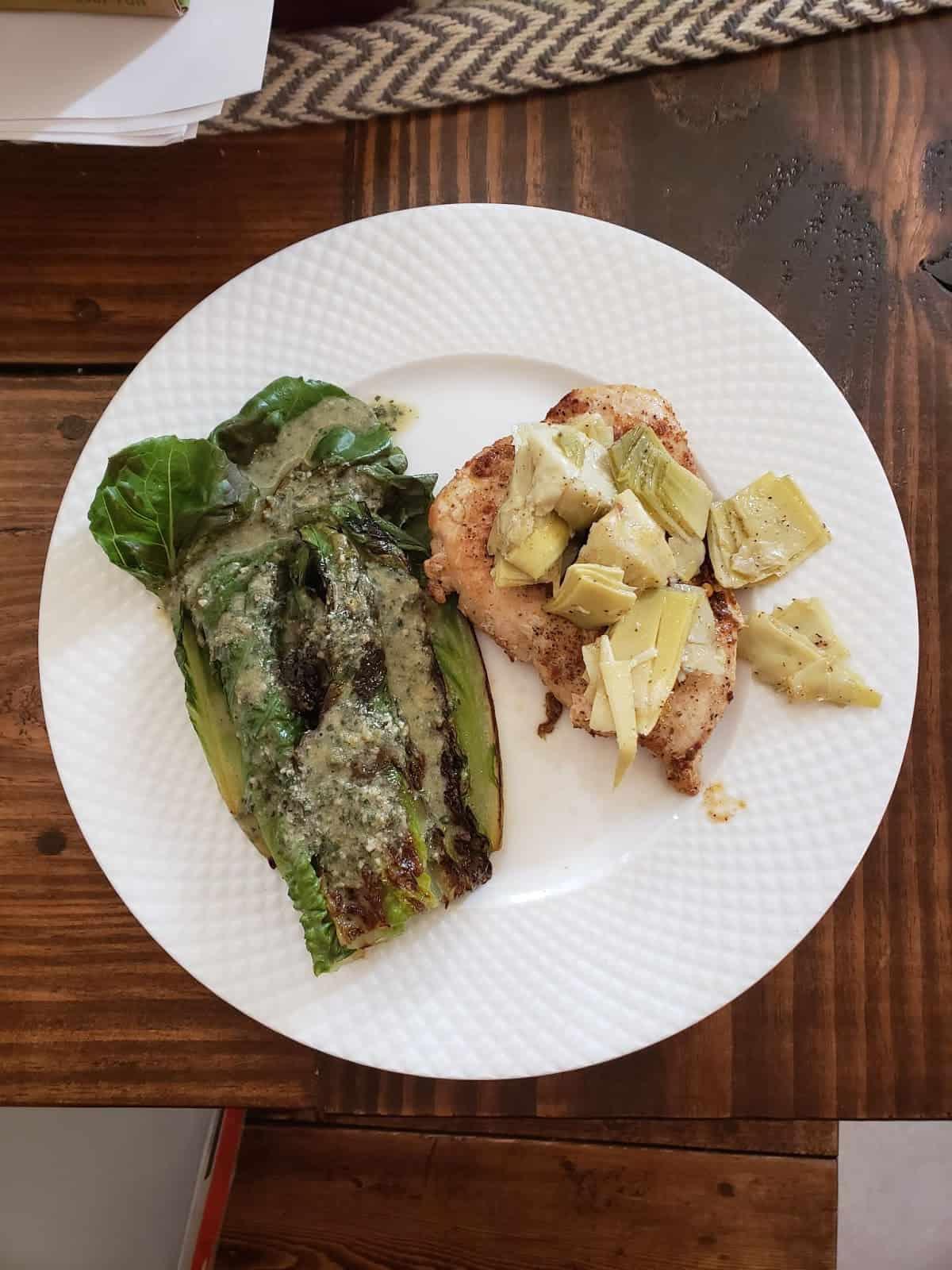 Harissa-Rubbed Chicken with Artichoke Tapenade and Seared Romaine